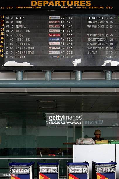 An Indian paramilitary official stands guard at the Indira Gandhi International Airport in New Delhi on December 4 2008 Security has been beefed up...