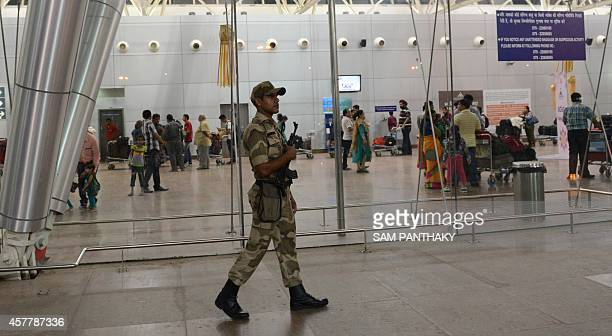 An Indian paramilitary soldier from the Central Industrial Security Force keeps vigil at the Sardar Vallabhbhai Patel International airport in...