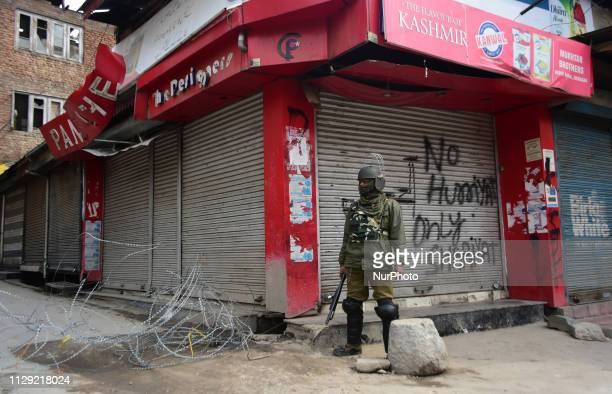 An Indian Paramilitary soldier stands alert during restrictions in Srinagar Indian Administered Kashmir on 08 march 2019 Kashmir shuts over the...