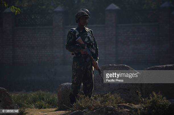 An Indian paramilitary soldier stands alert near the encounter site in PamporeTwo to three suspected militants are believed to be holed up in the...