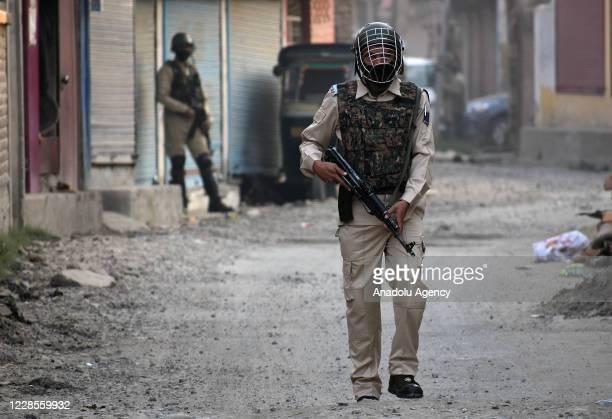An Indian paramilitary soldier stands alert near the site of gunbattle in Batmaloo area of Srinagar Kashmir on September 17 2020 Massive anti India...