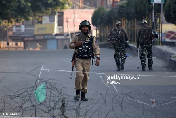 An Indian paramilitary soldier walks near the check point in SrinagarKashmir on September 08 2019Government imposed strict curfew like restrictions...