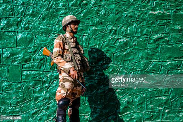 An Indian paramilitary trooper stands alert at a polling station during the third phase of municipal polls on October 13 2018 in Srinagar the summer...