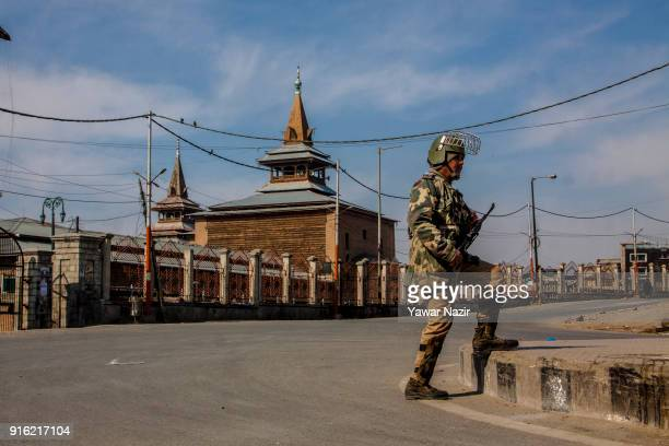 An Indian paramilitary trooper stands guard in front Kashmir's Jamia Masjid in the Old City during restrictions on the fifth death anniversary of...