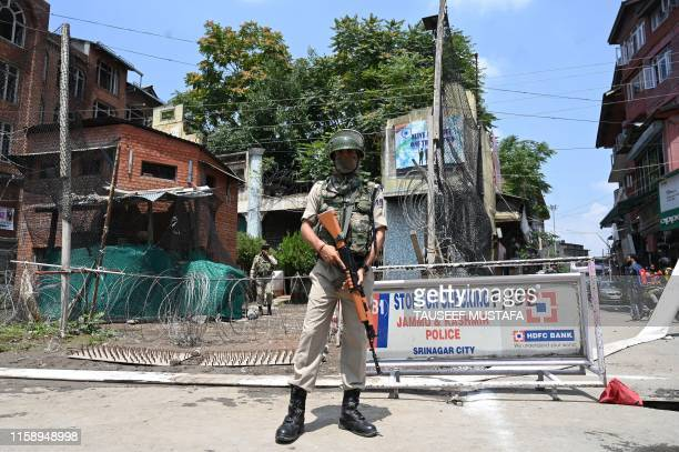 An Indian paramilitary trooper stands guard in Srinagar on August 2 2019