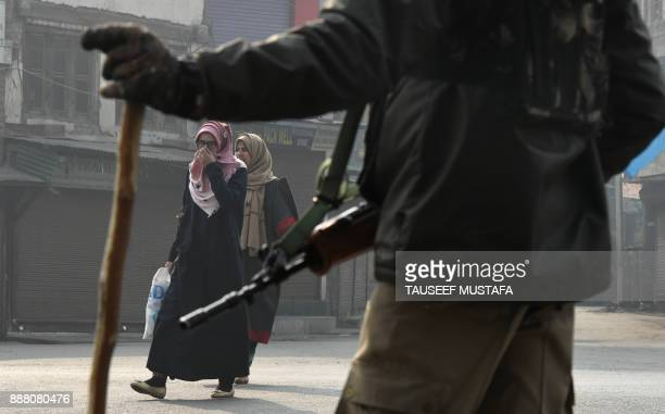 TOPSHOT An Indian paramilitary trooper stands guard near Jamia Masjid mosque during a restriction in Srinagar on December 8 2017 A partial...