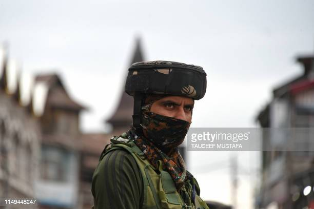 An Indian paramilitary trooper stands guard outside a bunker in Srinagar on June 12 following an attack to a Central Reserve Police Force patrol were...