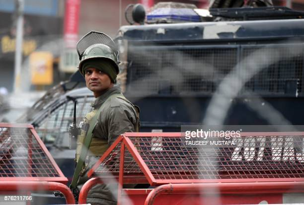 An Indian paramilitary trooper stands guard the day after a gunfight between suspected militants and Indian government forces in downtown Srinagar on...