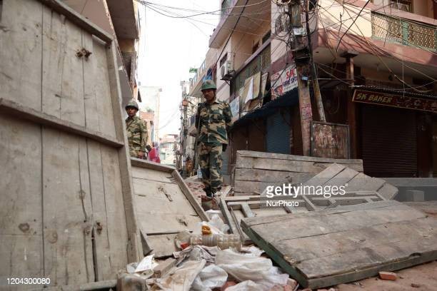 An Indian paramillitary trooper stands min a riot hit area Mustafabad New Delhi India on 29 February 2020 More than 40 people have been killed and...