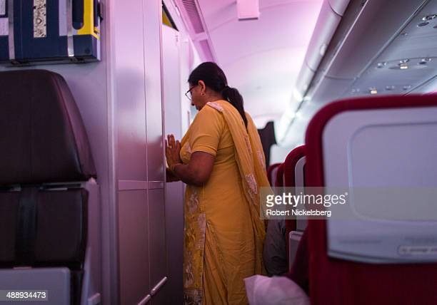 An Indian passenger moves from her seat on a Virgin Atlantic plane March 9 2014 after departing New Delhi India for London England