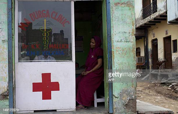 An Indian patient looks on at a small roadside clinic in a slum in New Delhi on July 23 2012 New HIV cases among adults have declined by half in...