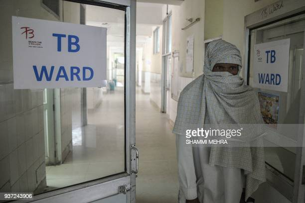An Indian patient who has been diagnosed with tubercolosis looks out from a TB ward at a government hospital in Jalandhar on March 24 on World...