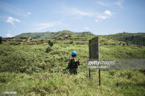 An Indian peacekeeper from the MONUSCO, the UN peacekeeping mission in the Democratic Republic of the Congo, stands guard during a press trip to the...