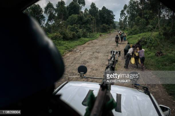 An Indian peacekeeper from the MONUSCO, the UN peacekeeping mission in the Democratic Republic of the Congo, holds a machine gun while protecting a...