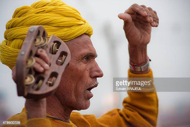 CONTENT] An Indian performing an Hindu ritual on banks of Ganges during Maha Kumbh Mela at Haridwar in India