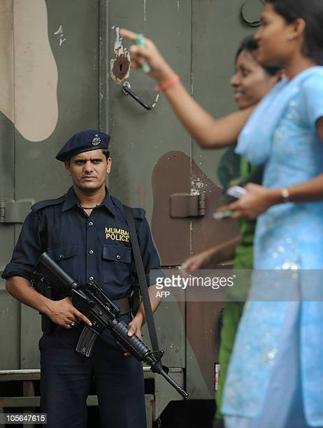 An Indian police commando stands guard outside the hight court where Mohammed Ajmal Amir Kasab's appeal is being held in Mumbai on October 18 2010...