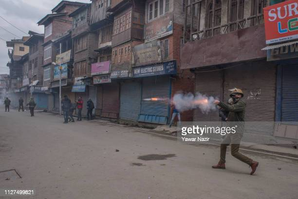 An Indian police officer fires a teargas shell at Kashmiri Muslim protesters outside the house of Yasin Malik leader of the Kashmiri resistance party...