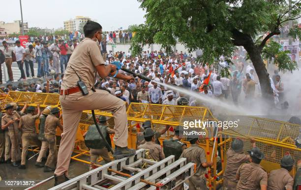 An Indian Police use water cannons to disperse Rajasthan Youth Congress workers who were holding a protest over Rafale Jet deal 'multi crore scam '...