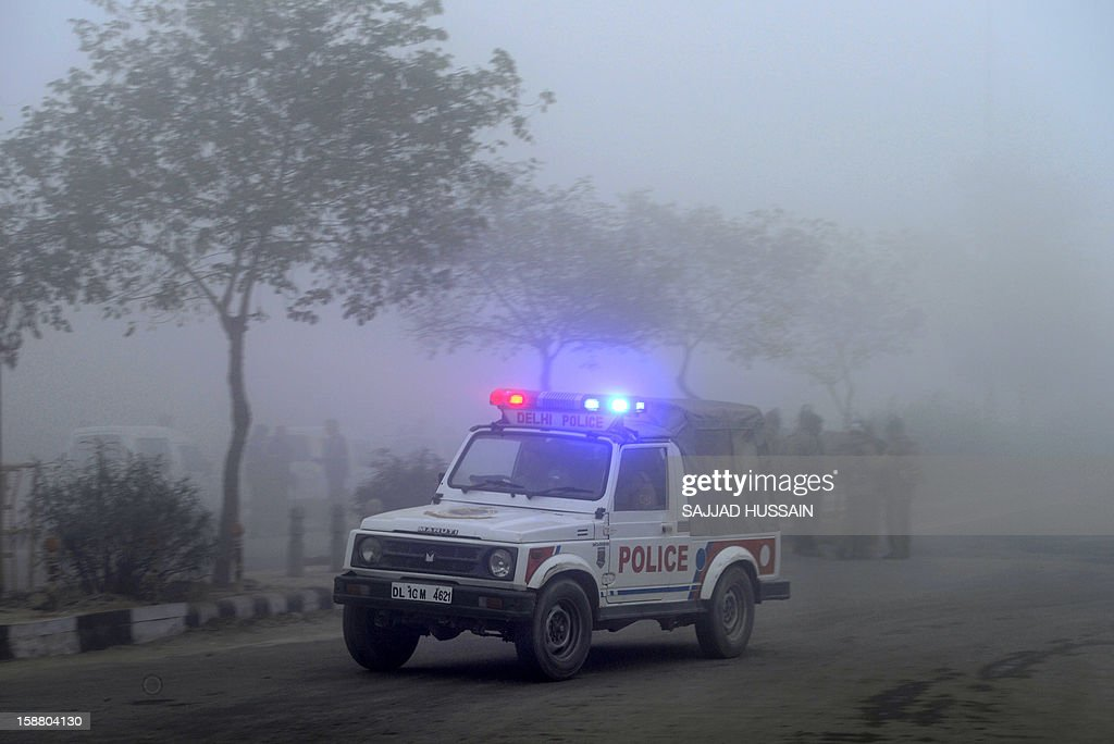 An Indian police vehicle patrols outside a cremation ground in New Delhi on December 30, 2012, ahead of a cremation ceremony for a gangrape victim. The victim of a gang-rape and murder which triggered an outpouring of grief and anger across India was cremated at a private ceremony, hours after her body was flown home from Singapore. The unidentified 23-year-old, the focus of nationwide protests since she was brutally attacked on a bus in New Delhi two weeks ago, was cremated away from the public glare at the request of her traumatised parents.