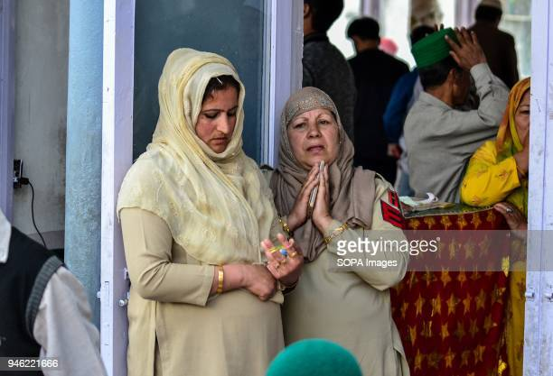 An Indian police woman prays on the occasion of the Islamic festival ShabeMeraj at Hazratbal Shrine in Srinagar Indian administered Kashmir...