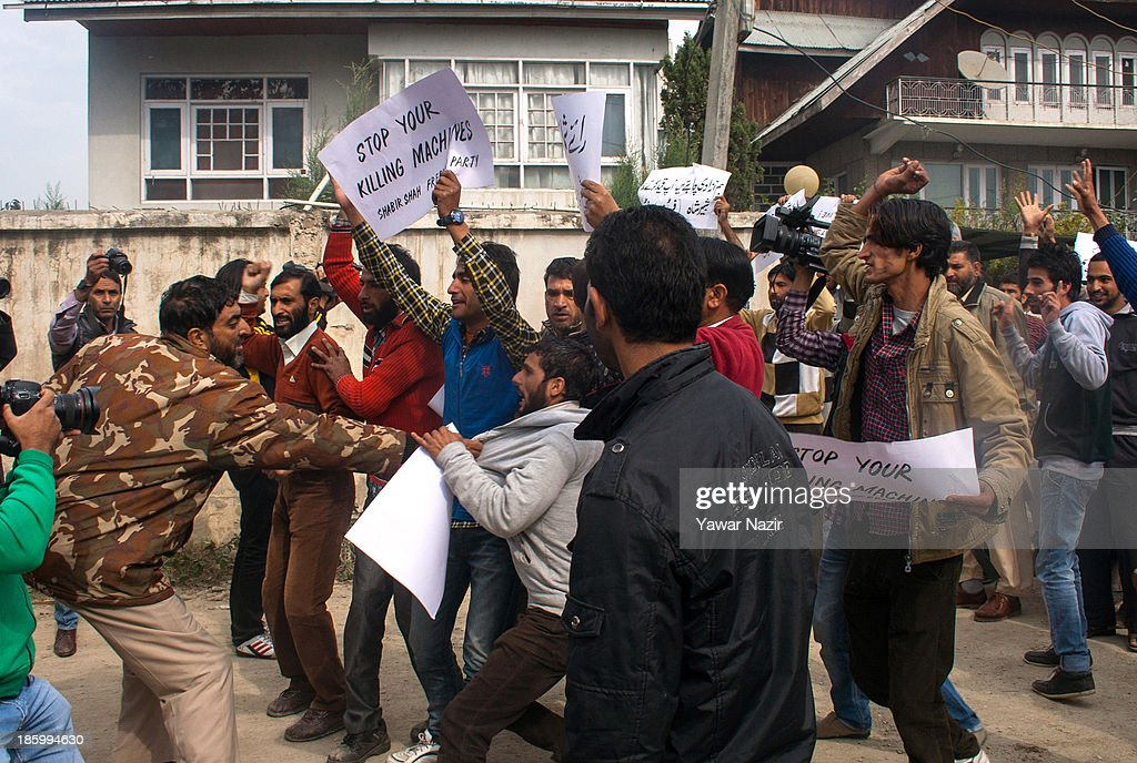 An Indian policeman detains a supporter of Shabir Shah a resistance leader as they protest against the landing of Indian army in Kashmir on October 27, 2013 in Srinagar, the summer capital of Indian administered Kashmir, India. A shutdown called by many resistance groups against the landing of the Indian army in Indian administered Kashmir on October 27, in 1947. Kashmir observes shut down on this day 'since the beginning of an armed rebellion' to protest the landing of Indian army in the mountainous region after the king of the former Independent princely state signed a conditional instrument of accession with the Indian union in 1947. The Indian army landed to quell an internal revolt aided by tribal warriors from Pakistan.