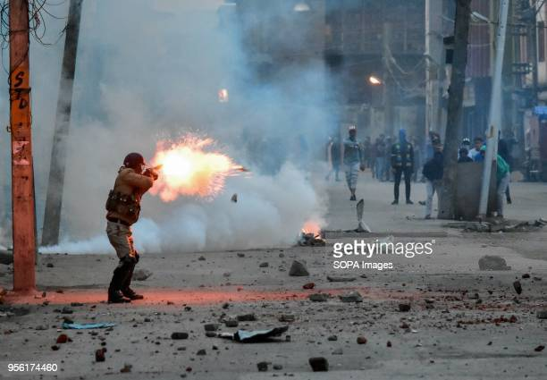 An Indian policeman fire tear gas shell towards Kashmiri protesters during clashes in Srinagar Indian administered Kashmir Fierce clashes broke out...