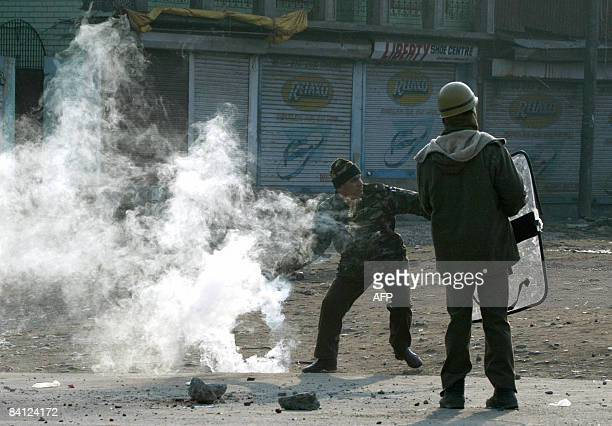 An Indian policeman reacts against unseen Kashmiri demonstrators during a protest in downtown Srinagar on December 26 2008 Militant violence in...
