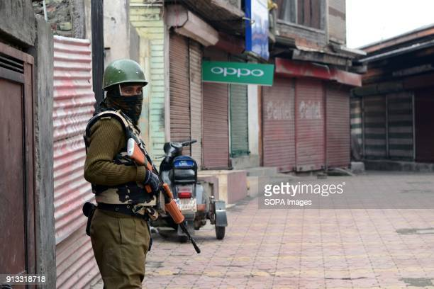 An Indian policeman stands guard during curfew in Srinagar Indian administered Kashmir A march called by the separatists was foiled and dozens of...