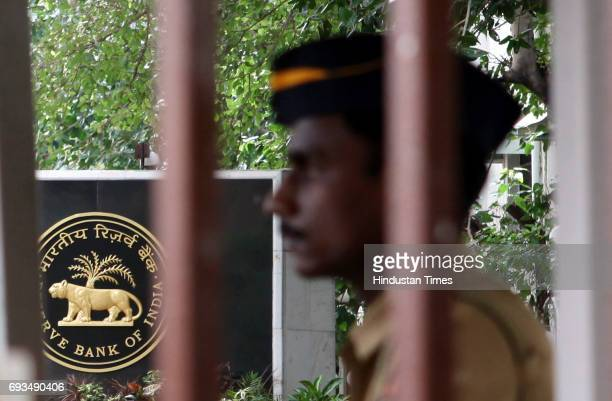 An Indian policeman stands guard outside the head office of the Reserve Bank of India in Mumbai