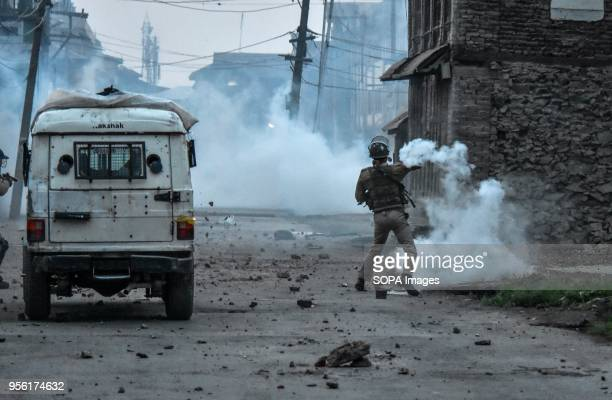 An Indian policeman throws a tear gas canister back towards Kashmiri protesters during clashes in Srinagar Indian administered Kashmir Fierce clashes...