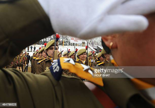 An Indian policewoman looks on while participating in a rehearsal for the upcoming 65th Republic Day in Srinagar on January 24 2014 India will...