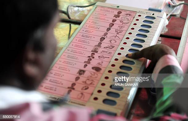 An Indian polling official checks the workings of Electronic Voting Machinesat a distribution point in Chennai on May 10 ahead of voting in state...