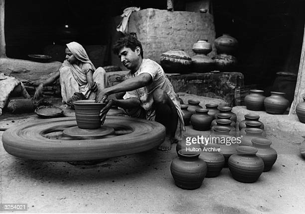 An Indian potter at work on his wheel