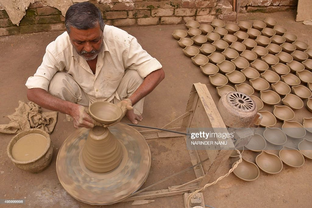An Indian potter makes clay `diyas` ahead of the Hindu festival of Diwali in Amritsar on November 6 2015 Diwali celebrated this year on November 11...