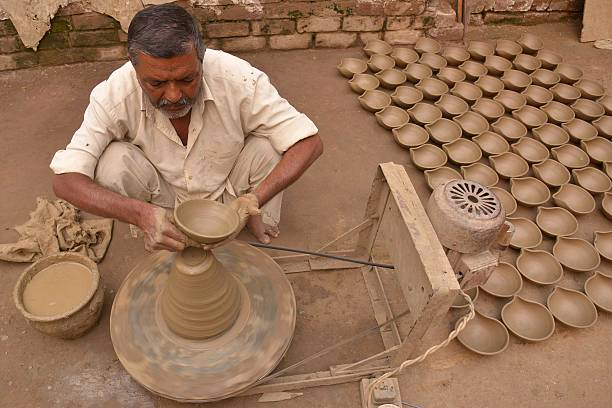 An Indian potter makes clay `diyas` ahead of the Hindu festival of Diwali in Amritsar on November 6 2015 Diwali celebrated this year on November 11...