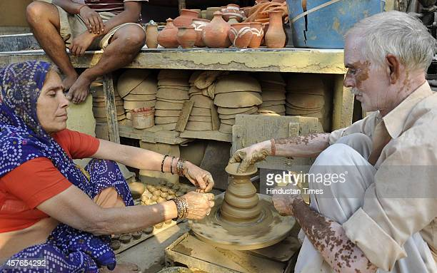 An Indian potter making the earthen lamps ahead of Hindu festival of Diwali on October 22 2014 in Ghaziabad India Prime Minister Narendra Modi has...