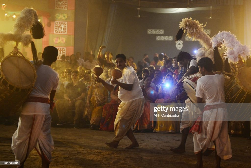 An Indian priest performs a ritual for during the Hindu festival Durga Puja in Allahabad on September 27 2017 The fiveday Durga Puja festival...