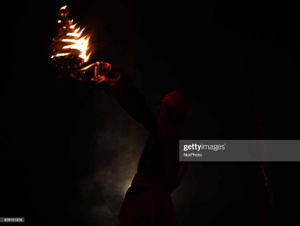 An Indian priest performs an evening aarti, on the banks of Holy sangam, confluence of Ganges,yamuna and Mythical Saraswati river, in Allahabad on December 11,2016.
