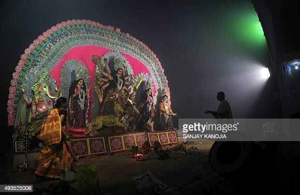 An Indian priest performs rituals during the Hindu festival Durga Puja in Allahabad on October 20 2015 The fiveday Durga Puja festival commemorates...