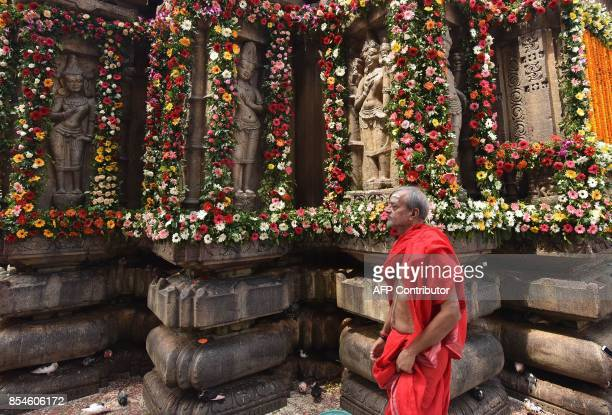 An Indian priest walks after offering his prayer at Kamakhya Temple in Guwahati on September 27 2017 Thousands of devotees gather to attend the Durga...