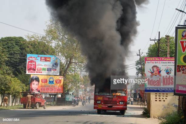 An Indian public bus burn during countrywide protests against a Supreme Court order that allegedly diluted the Scheduled Castes and Scheduled Tribes...