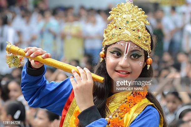 An Indian pupil dressed as the Hindu god Krishna poses on the eve of the Janmashtami festival at a school in Amritsar on August 27 2013 The Hindu...