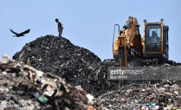 An Indian ragpicker looks for recyclables items at one of the largest disposal sites in northeast India ahead of the 'World Environment Day' in...