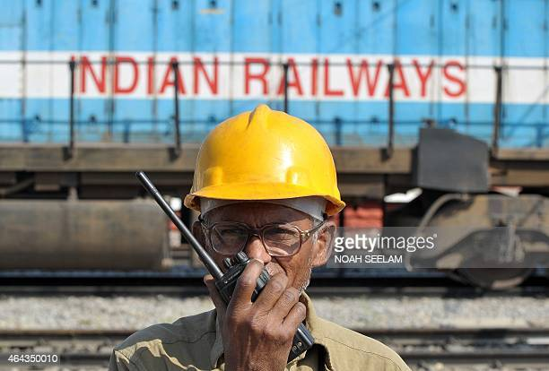 An Indian railway signalman talks on a radio at a railway station in Secunderabad the twin city of Hyderabad on February 25 2015 Indian Railways...