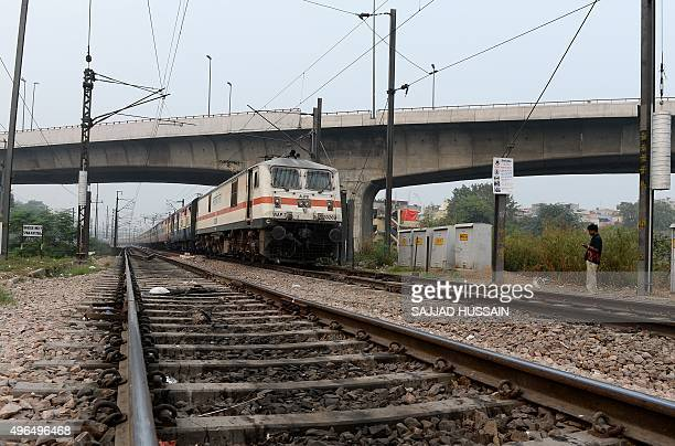 An Indian Railways passenger train travels on a railway track in New Delhi on November 10 2015 French engineering firm Alstom has won a contract...