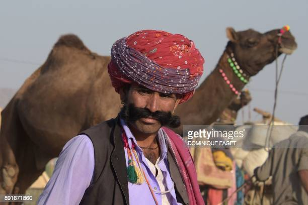 An Indian Rajput looks on at the Pushkar Camel Fair in Pushkar in Rajasthan state on October 26 2017 Thousands of livestock traders from the region...