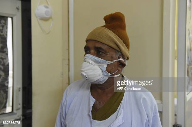 An Indian relative of a Swine flu patient looks on at the Ahmedabad Civil Hospital in Ahmedabad on August 12 2017 / AFP PHOTO / SAM PANTHAKY