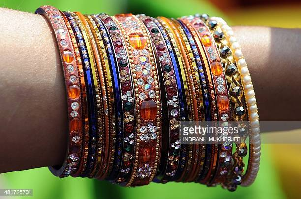 An Indian resident wearing traditional bangles and jewellery takes part in a procession celebrating 'Gudi Padwa' or the Maharashtrian new year in...