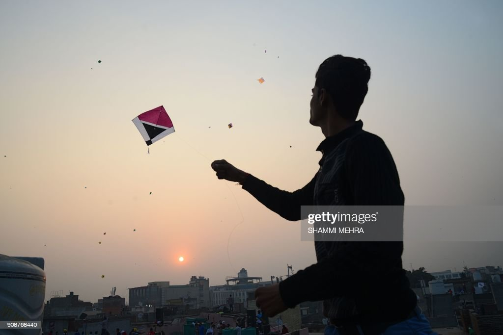 An Indian residents flies a kite from a roof on the ocassion of `Basant Panchami` festival in Jalandhar on January 22 2018 Basant Panchami is a...