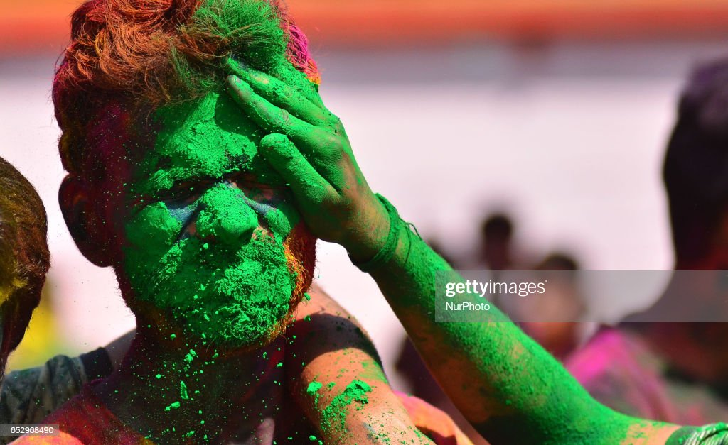 An Indian reveller reacts as he is smear with colour during Holi celebration in Dimapur, India north eastern state of Nagaland on Monday, March 13, 2017. Holi, the festival of colours, is a riotous celebration of the coming of spring and falls on the day after full moon annually in March.